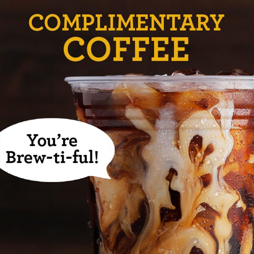 image of a cup of Einstein Bros. Bagels coffee with a compliment on the sleeve.